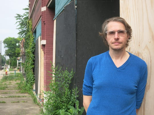 Cafe Muse chef Greg Reyner in July 2015 standing in front of the Kercheval Avenue building that will become Marrow restaurant and butcher shop in Detroit's West Village neighborhood.
