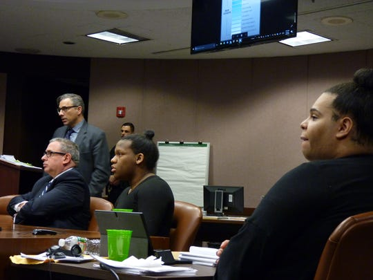 """From left: Attorneys Anthony Cowell and Louis Mangione with their clients, Carlos """"Royal"""" Martinez and Harry """"Nalani"""" Wilkins."""