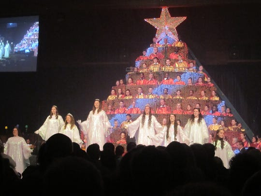 About 8,000 people attended the Singing Christmas Tree