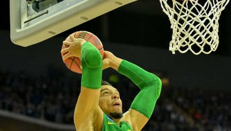 Mar 25, 2017; Kansas City, MO, USA; Oregon Ducks forward Dillon Brooks (24) goes up for a dunk ahead of Kansas Jayhawks guard Frank Mason III (0) during the first half in the finals of the Midwest Regional of the 2017 NCAA Tournament at Sprint Center. Mandatory Credit: Denny Medley-USA TODAY Sports