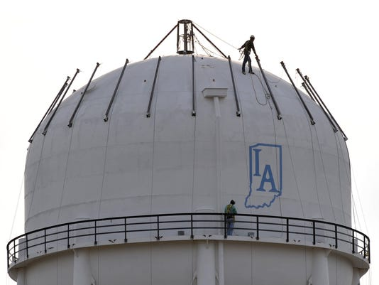 Repainting the water tower in Richmond