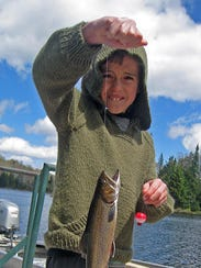 Cam Stedman holds up a native brook trout.