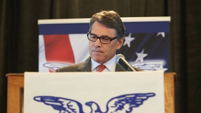 Rick Perry addresses the Eagle Forum in St. Louis where he suspended his 2016 GOP presidential campaign.