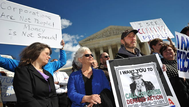 Demonstrators outside the Supreme Court call for a reversal of the 2010 'Citizens United' decision on Feb. 23, 2012.