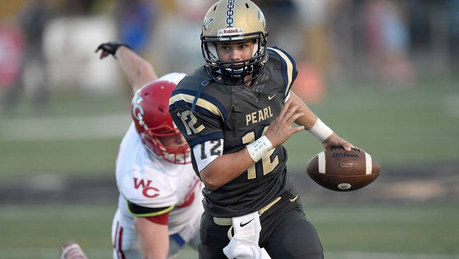 Pearl quarterback Jake Smithhart (12) evades the Warren Central pass rush on Friday, August 26, 2016, at Pearl High School in Pearl, Miss.
