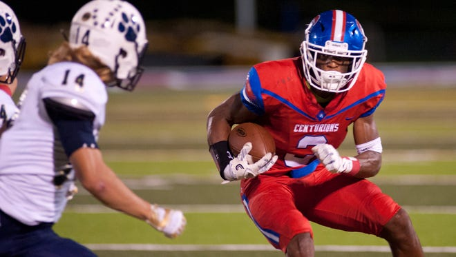 CAL wide receiver Milton Wright looks to get past Elizabethtown safety Jay Becherer.08 September 2017