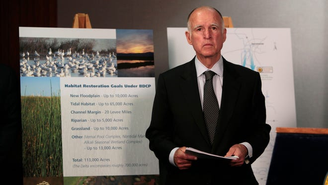 Gov. Jerry Brown waits for the start of a news conference July 25, 2012, in Sacramento to announce plans to build a giant twin tunnel system to move water from the Sacramento-San Joaquin River Delta to farmland and cities.