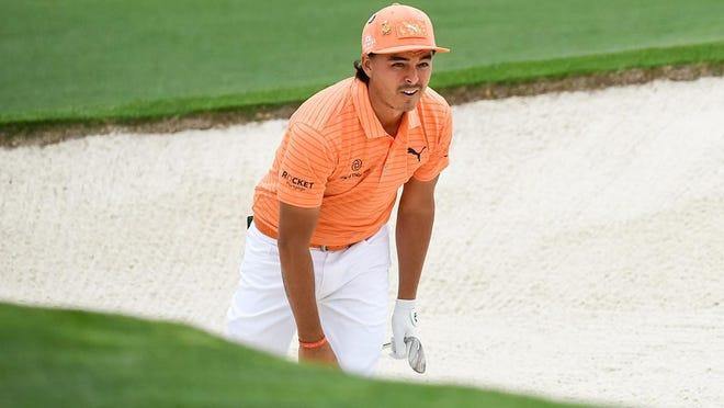 Rickie Fowler's Sunday orange is in homage to his roots at Oklahoma State University. He and former Cowboys Charles Howell and Matthew Wolff hope to win the program's first Masters title this week.