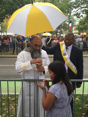Theresa Malley, 11, receiving communion at the Papal Mass.