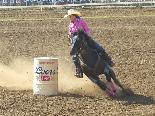 World champion barrel racer Nellie Miller of Cottonwood and her horse Sister make a turn during the 2018 Red Bluff Round-Up. Miller is competing again this year at her hometown rodeo.