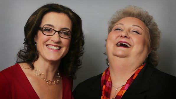 """Current City Council Member Molly Clifford and former Council Member Carla Palumbo """"posing"""" for a photo."""