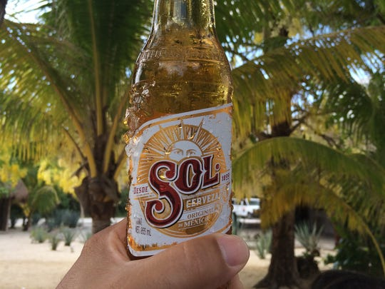 Sol is a light Mexican lager beer that combines with heat, pool, sea and party; good drinkability in these situations only.