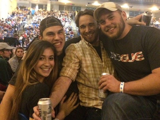 In 2016, University of Delaware senior Colt Armstrong (second from left) with friends Kaitlin Gorrell, Mike Hammond and Jared McCabe at the Chris Young concert in Newark. The Bob Carpenter Center began serving alcohol that year.