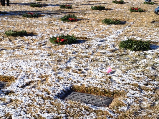 Small pink flags marked the graves of veterans whose families were present to lay a wreath at their loved one's grave at the Wreaths Across America ceremony at the Northern Nevada Veterans Memorial Cemetery in Fernley Saturday.