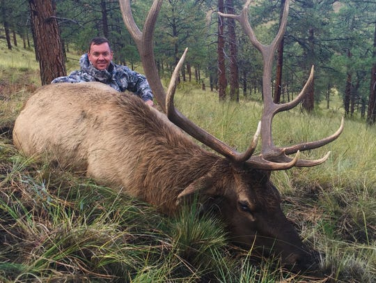 Cox loves to hunt. He is shown here with an elk he