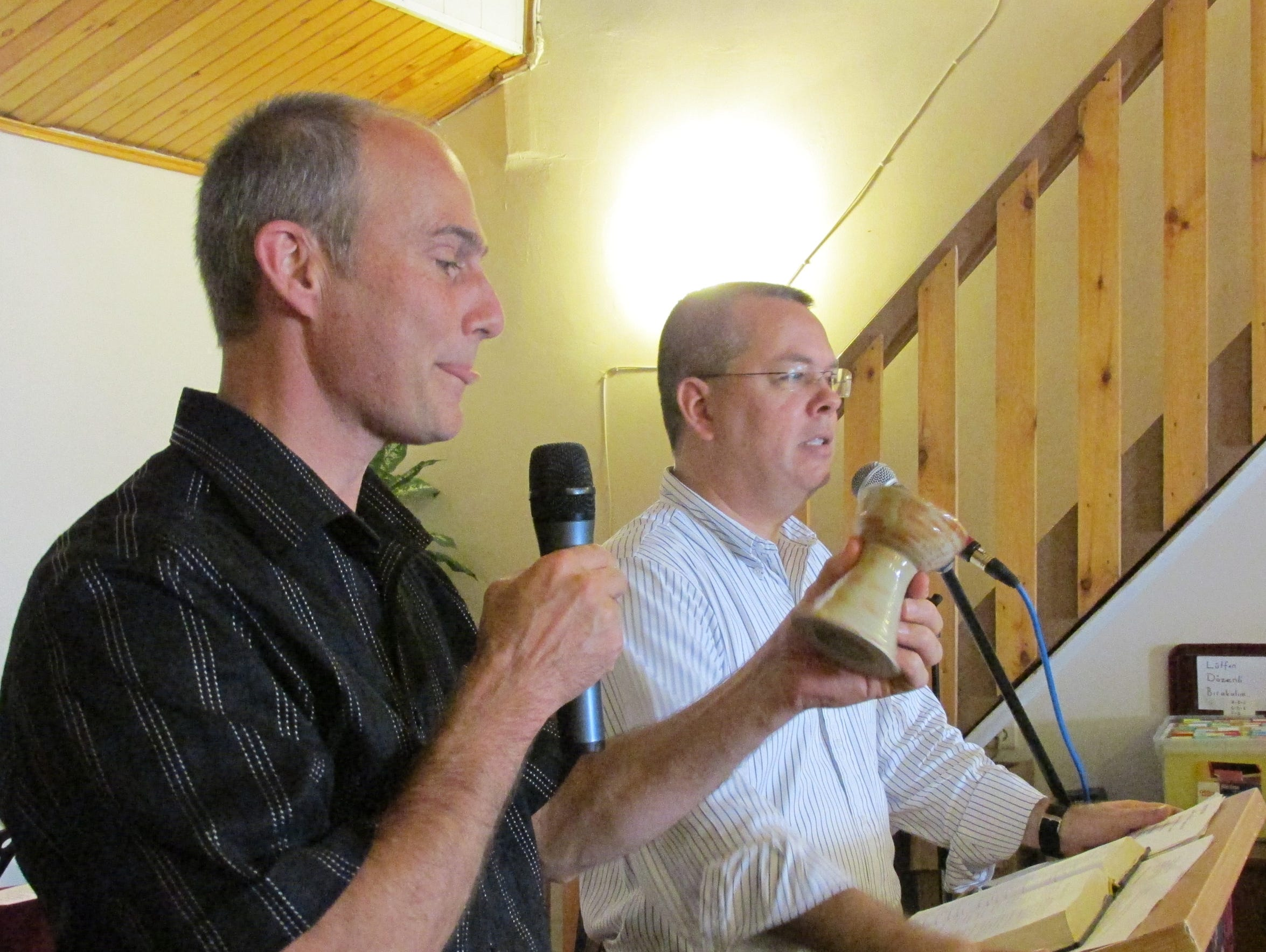 The Rev. Edward Brouwer, left, presents the Rev. Andrew