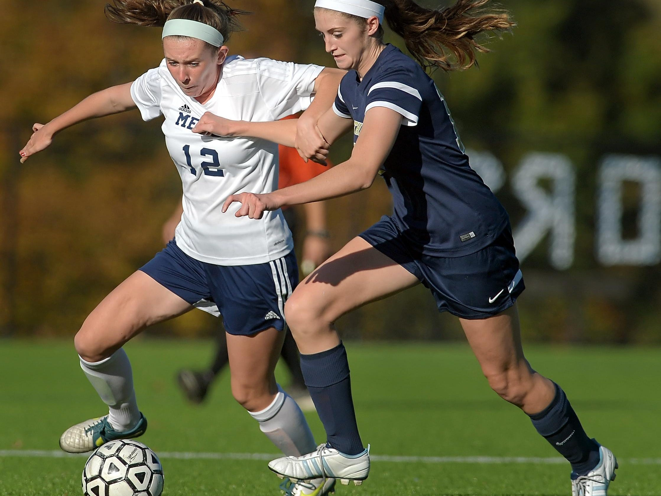 Mercy's Elizabeth Glynn, left, and Pittsford Sutherland's Emily Marshall chase a loose ball during a regular season game played at Our Lady of Mercy High School on Monday, October 12, 2015. Pittsford Sutherland beat Mercy 2-0.