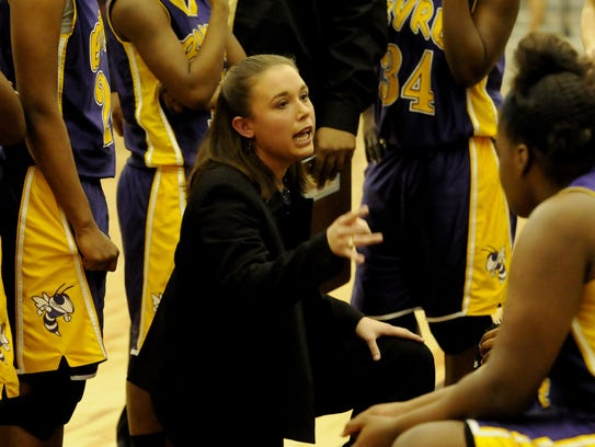 Byrd's Toni Martinez talks with her team during a past