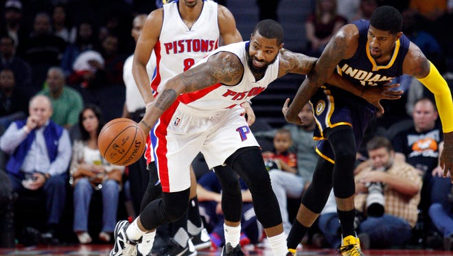 Detroit Pistons forward Marcus Morris (13) fights for a loose ball against Indiana Pacers forward Paul George (13) during the first quarter at The Palace of Auburn Hills.