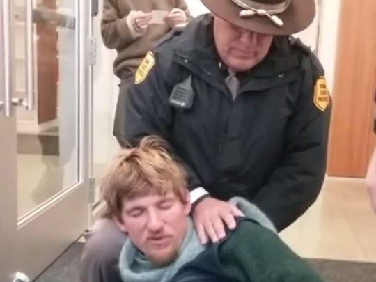 A screenshot of a Facebook Live video showing Travis