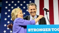 Presidential candidate Hillary Clinton hugs U.S. Senator