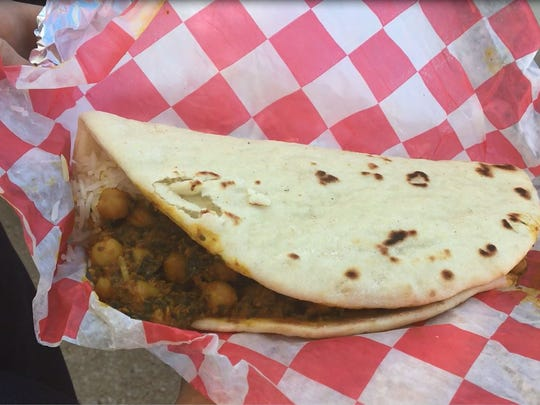 A chole palak naan taco from Holy Cow Food Truck is