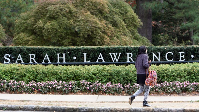 A student walks Oct. 31 on the Sarah Lawrence College campus in Yonkers. A flurry of sexual assault reports in the fall on the campus embroiled students, administrators and parents in controversy.