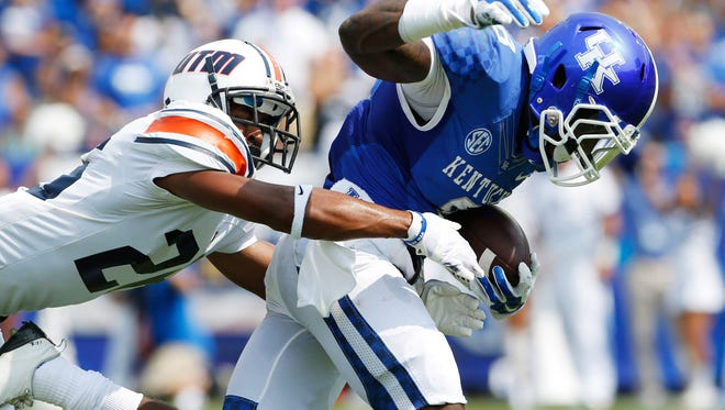 Aug 30, 2014; Lexington, KY, USA; UT Martin Skyhawks defensive back Walter Evans (26) tackles Kentucky Wildcats wide receiver Javess Blue (8) in the first half at Commonwealth Stadium. Mandatory Credit: Mark Zerof-USA TODAY Sports