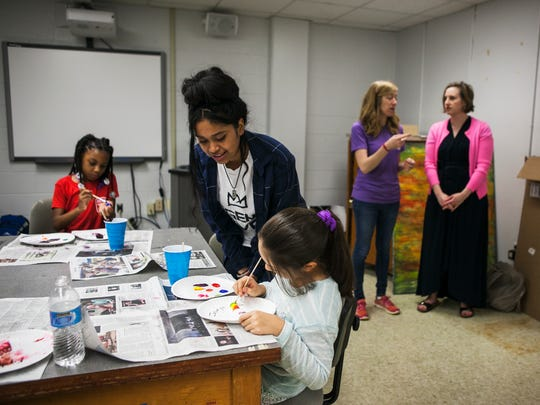 June 22, 2017 - Dixon Art Camp intern Arely Herrera, 17, looks at the work in progress by 9-year-old student, Jasmyn Gomez Martinez, during camp at the University of Memphis on Thursday. The free summer camp marks the third time Dixon Gallery and Gardens has partnered with U of M to offer the opportunity to students, from first through eighth grade, whose families live in neighborhoods around Dixon and the university.