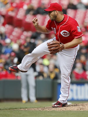 Reds relief pitcher J.J. Hoover follows through on a pitch in the top of the ninth inning.
