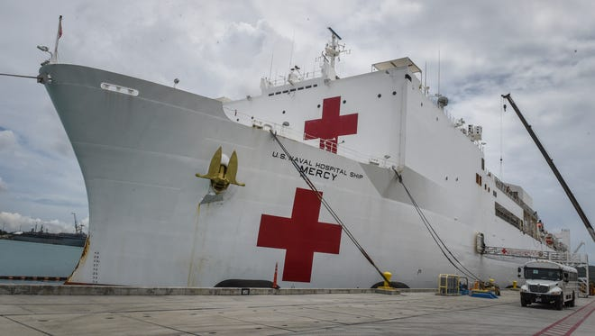 The USNS Mercy, one of two Navy hospital ships, makes a port call to Naval Base Guam in September 2015.