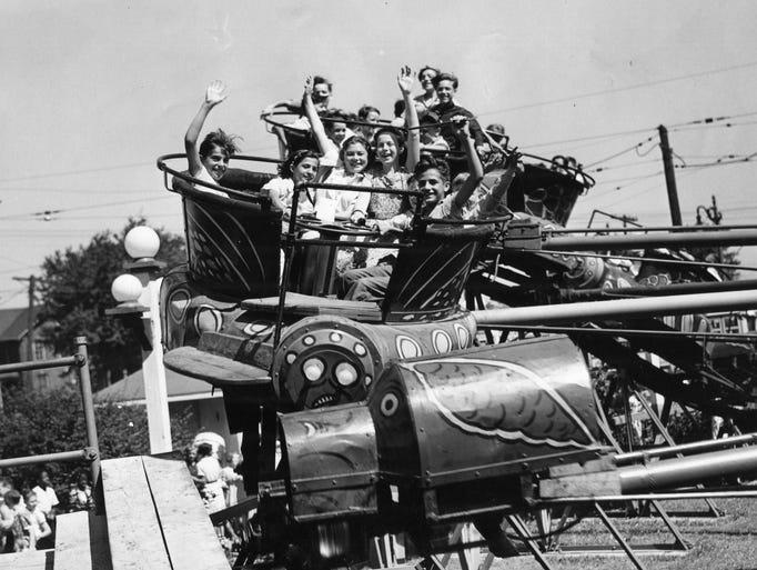 Kids enjoy one of rides at Eastwood Amusement Park
