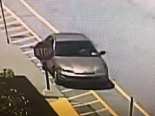 State police said two men left in this gold Honda Accord