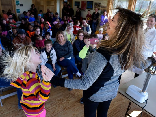 Maggie Burch 7, and her mother AnnRose Burch enjoy a demonstration about electric current during the Science Spectacular at Shelby Bottoms Nature Center on Saturday in Nashville.