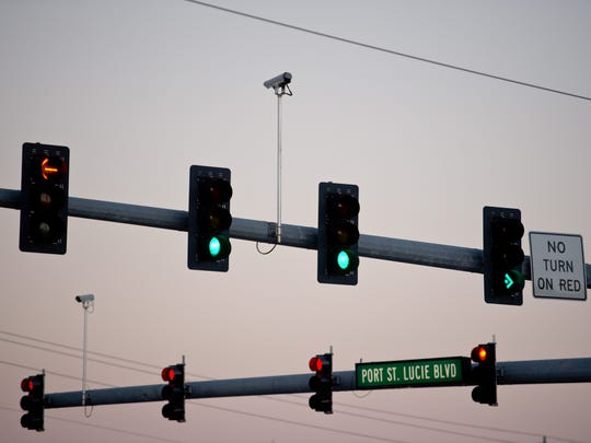 Multiple cameras posted above traffic are seen Nov. 16, 2016, at the intersection of Port St. Lucie Boulevard and U.S. 1 in Port St. Lucie.