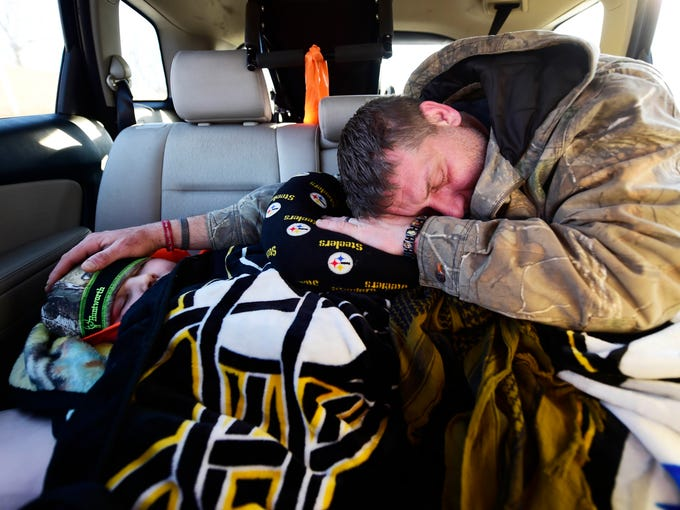 Bill Kohler sleeps on top of his 10-year-old son, Ayden