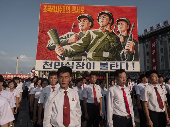 A propaganda poster is displayed during a rally in