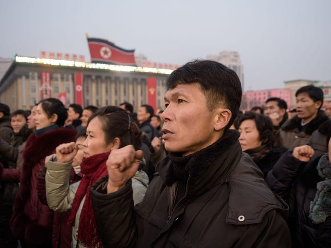 Attendees shout slogans during a rally in support of