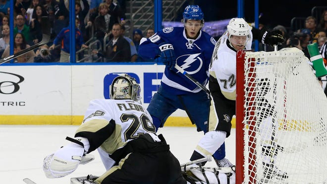 Tampa Bay Lightning center Vladislav Namestnikov (90) scores the game winning goal for a hat trick during overtime against the Pittsburgh Penguins at Amalie Arena.