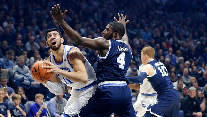 Xavier Musketeers forward Kerem Kanter (11) feels the pressure of Villanova Wildcats forward Eric Paschall (4) in the first half at the Cintas Center Saturday Feb. 17, 2018.