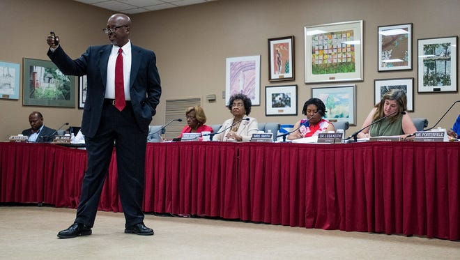 AdvancEd Alabama Director Andre Harrison presents accreditation review findings to the Montgomery School Board in Montgomery, Ala. on Wednesday May 30, 2018.