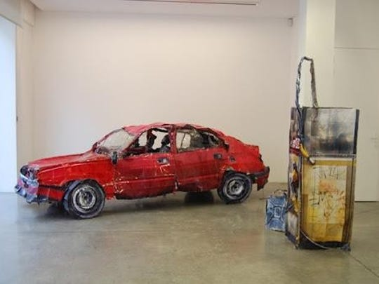 A sculpture of  a crashed car made from Cyrill Hatt's photographs.