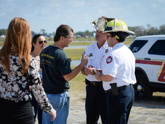 Pedro Reis, founder and CEO of the Circus Arts Conservatory, speaks with the Sarasota Fire Department prior to a press conference Wednesday, Feb. 8, 2017, in Sarasota, Fla., about the five people that were injured while rehearsing the final act, an eight person pyramid on a high wire, for the upcoming Circus Sarasota show Synergy. (Rachel S. O'Hara/Sarasota Herald-Tribune via AP)