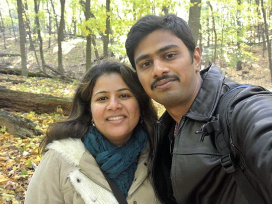 """In this undated photo provided by Kranti Shalia, Srinivas Kuchibhotla, right, poses for photo with his wife Sunayana Dumala in Cedar Rapids, Iowa. In the middle of a crowded bar, a 51-year-old former air traffic controller yelled at two Indian men - Kuchibhotla and Alok Madasani - to """"get out of my country,"""" witnesses said, then opened fire in an attack that killed one of the men and wounded the other, as well as a third man who tried to help, Thursday, Feb 23, 2017, in Olathe, Kan."""