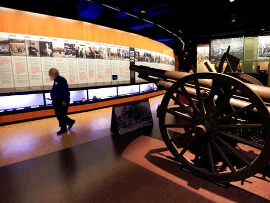 In this Feb. 16, 2017 photo a docent walks past a French artillery piece at the National World War I Museum in Kansas City, Mo.