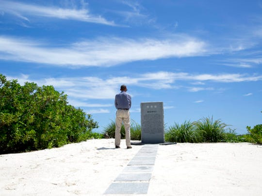 """FILE - In this Sept. 1, 2016, file photo, President Barack Obama pauses at the Battle of Midway Navy Memorial as he tours on Midway Atoll in thePapahanaumokuakea Marine National Monument, Northwestern Hawaiian Islands. President Donald Trump signed an executive order Wednesday, April 26, 2017, directing his interior secretary to review the designation of dozens of national monuments on federal lands, as he singled out """"a massive federal land grab"""" by the Obama administration."""