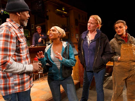 "This image released by Boneau.Bryan-Brown shows, foreground from left, John Earl Jelks, Michelle Wilson, Johanna Day and Alison Wright during a performance of Lynn Nottage's play, ""Sweat,"" at Studio 54 in New York. The play, which was awarded the Pulitzer Prize for drama on April 10, is a likely contender for a Tony Award for best play. Tony Award nominations will be announced on Tuesday, May 2, 2017."