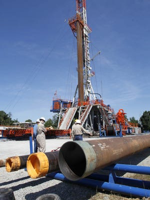 """More than 150 municipalities in New York have passed a ban or moratorium on gas drilling or fracking, according to FracTracker. Earlier this month, Schuyler County's Farm Bureau joined the fold. In this file photo, Range Resources workers stand near the rig that drills into the shale at a well site in Pennsylvania. FILE PHOTO More than 150 municipalities in new York have passed a ban or moratorium on gas drilling or fracking, according to FracTracker. ASSOCIATED PRESS / FILE PHOTO In this July 27, 2011 photo, Range Resources workers stand near the rig that drills into the shale at a well site in Washington, Pa. The company is one of many drilling and """"fracking"""" in the area to release natural gas. The three different diameters of pipe at bottom are the casing tubings that each go inside the other to line the well. Experts say Marcellus Shale natural gas production is expected to keep rising in 2012, yet landowners may find that signing lease deals isn't as easy as in years past. (AP Photo/Keith Srakocic)"""