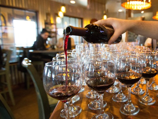 Chris Schaljo, co-owner of Salud de Mesilla, pours a Malbec from Amaro Winery for a dinner party of wine writers and vineyard owners on March 12 at Salud de Mesilla.
