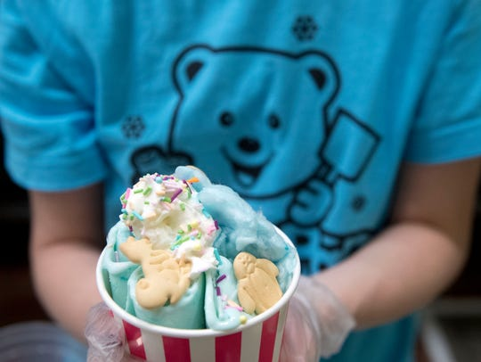 Ruby Freels presents a serving of Polar Pan rolled ice cream called Circus Party. It is topped with whipped cream, sprinkles and animal crackers.